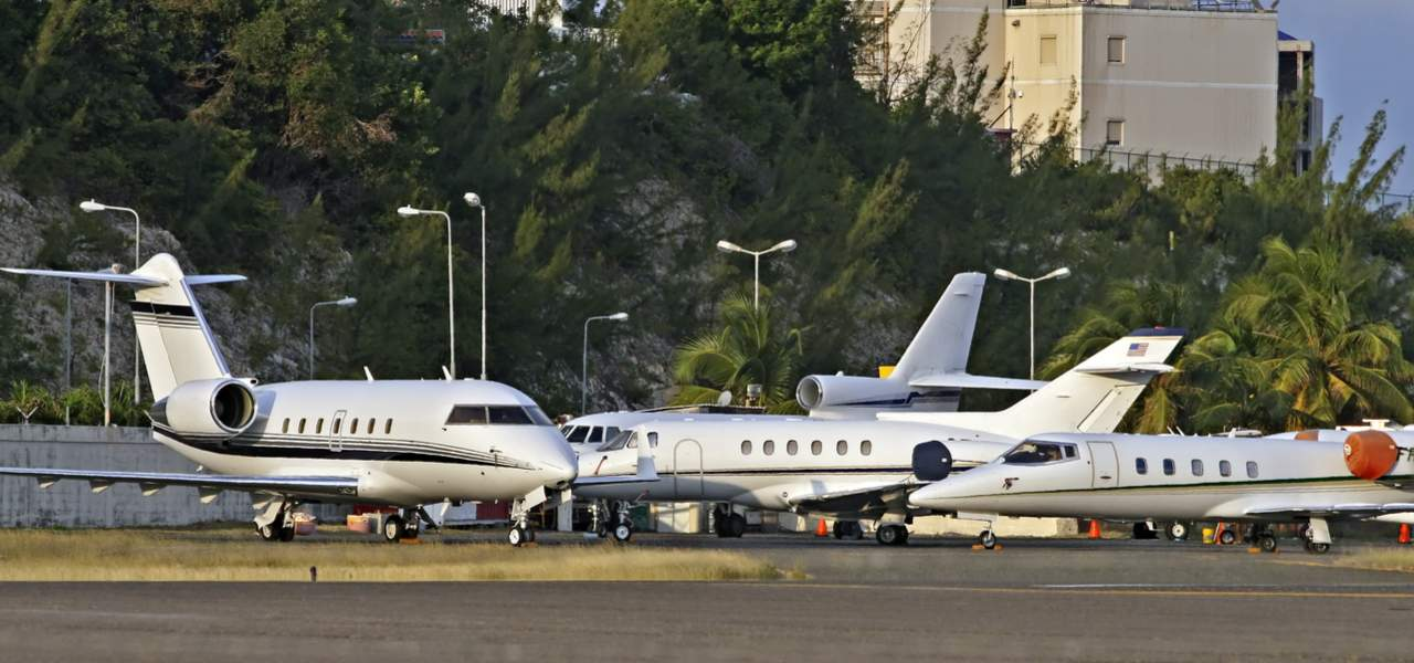 Private business jets parked on the ramp