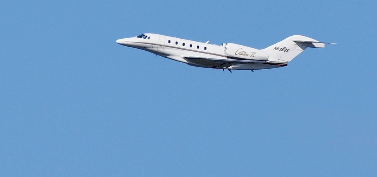 The Cessna Citation X in a blue cloudless sky