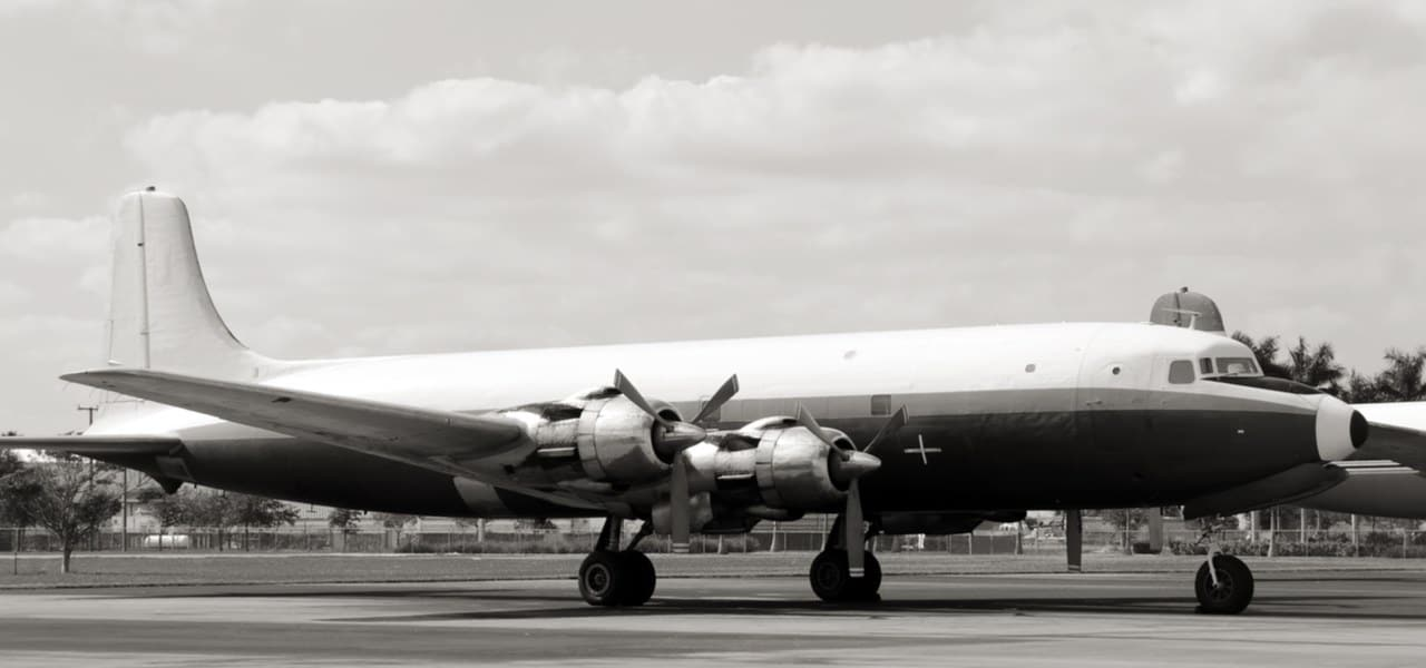 Vintage airliner from the 50s on the ground in black and white